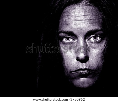 Closeup Portrait of a very disturbed Woman on Black - stock photo