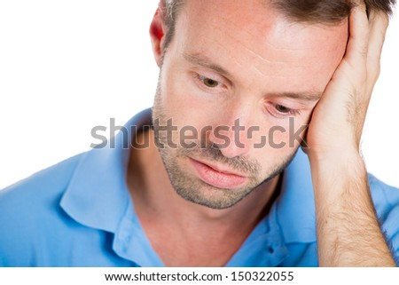 Closeup portrait of a very sad, depressed, alone, disappointed man resting his face on hand, side profile isolated on white background - stock photo