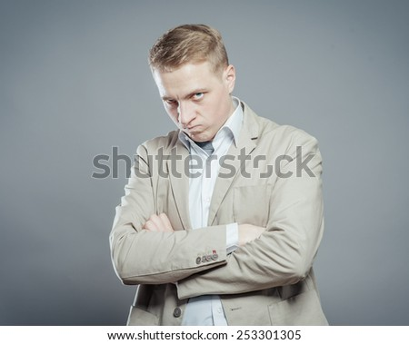 Closeup portrait of a very sad, depressed, alone, disappointed man resting his face on hands, side profile isolated on graybackground  - stock photo