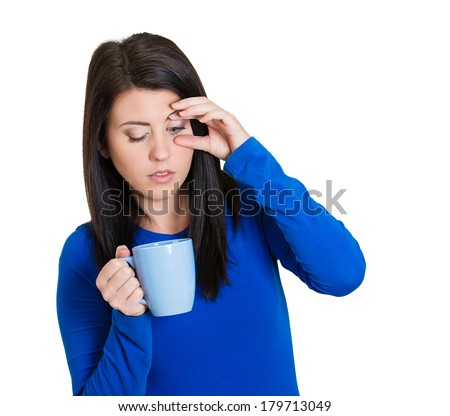 Closeup portrait of a very tired, falling asleep business young woman no energy motivation, struggling not to crash and stay awake, keeping her eyes opened, isolated white background. Human emotions - stock photo