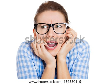 Closeup portrait of a woman wearing black glasses, biting nails and looking to the side with a craving for something or anxious, very insecure and scared, isolated on white background. Human emotions - stock photo
