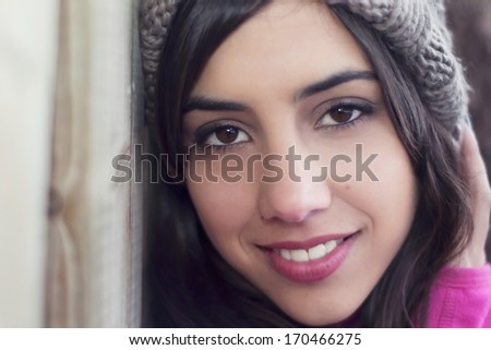 Closeup portrait of a woman with a grey knitted hat