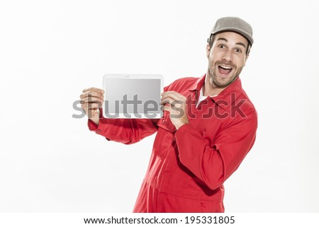 closeup portrait of a workman with expressive face showing us a digital tablet - stock photo