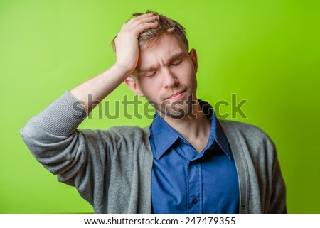 Closeup portrait of a young angry unhappy stressed man looking at you camera, stop making that loud noise it's giving me a headache. Negative emotion - stock photo