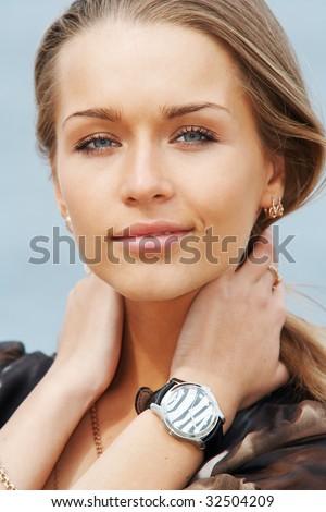 Closeup portrait of a young beautiful lady - stock photo