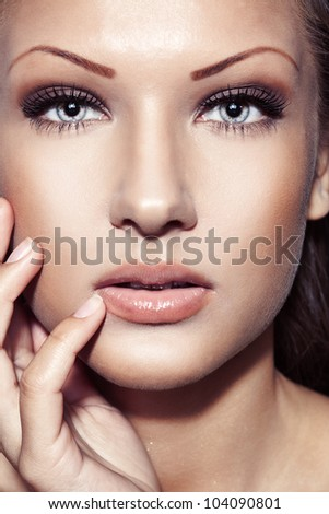 closeup portrait of a young beautiful sensual woman with perfect clean skin face , make up - stock photo