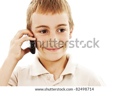 Closeup portrait of a young boy speaking on cellphone - stock photo