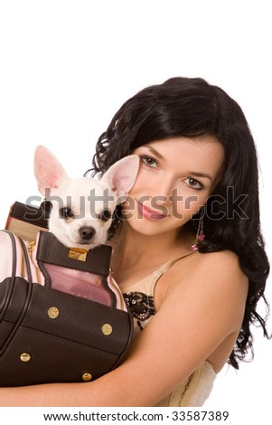 closeup portrait of a young brunette woman with dog on white background