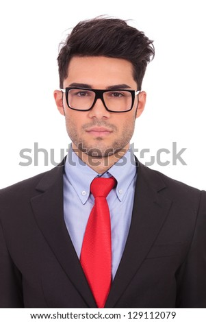 closeup portrait of a young business man looking serious at the camera on a white background