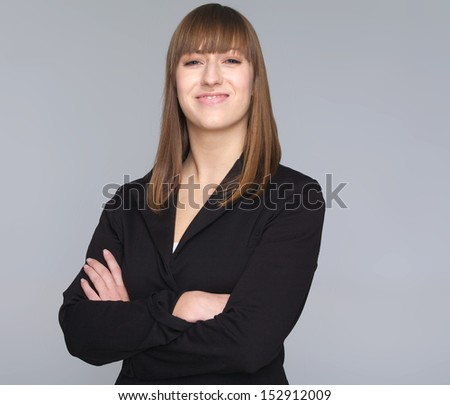 Closeup portrait of a young business woman isolated on gray background - stock photo