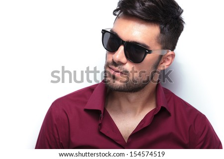 closeup portrait of a young casual man looking away from the camera. on white background - stock photo