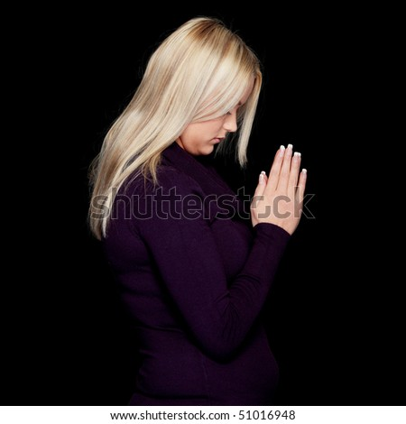 Closeup portrait of a young caucasian woman praying - stock photo