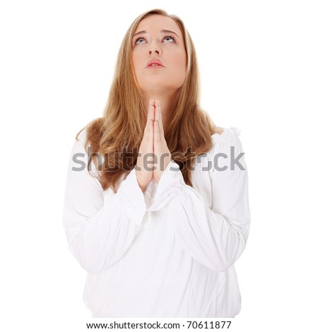 Closeup portrait of a young caucasian woman praying , isoalted on white