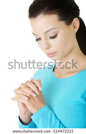 Closeup portrait of a young caucasian woman praying, isolated on white - stock photo
