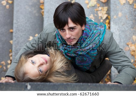 Closeup portrait of a young couple in the park - stock photo
