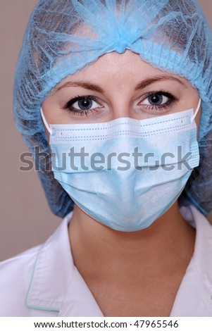 Closeup portrait of a young doctor wearing a mask