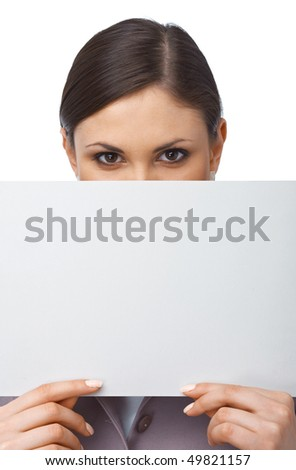 Closeup portrait of a young girl hiding behind an empty white billboard , isolated on white - stock photo