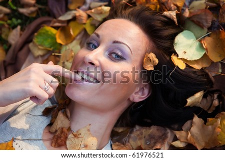 Closeup portrait of a young lady on grass - stock photo