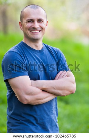 Closeup portrait of a young man outdoor with selective focus - stock photo