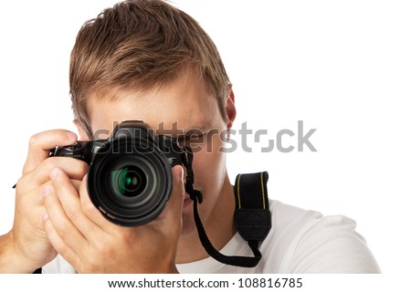 Closeup portrait of a young man taking a picture over white background - stock photo