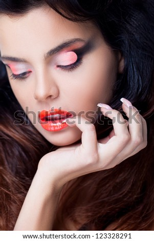 Closeup portrait of a young model with creative makeup - stock photo