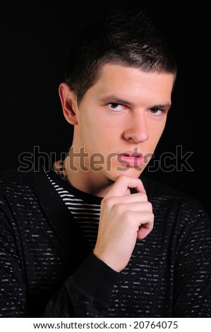 Closeup portrait of a young modern black haired man - stock photo