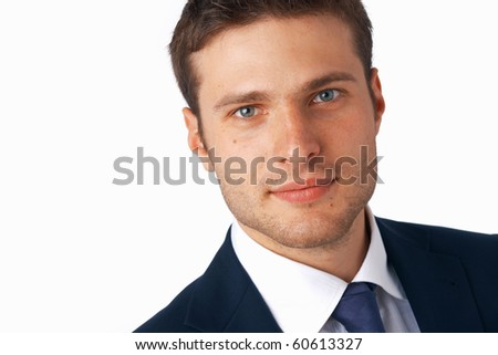 Closeup portrait of a young smiling businessman over white background. - stock photo