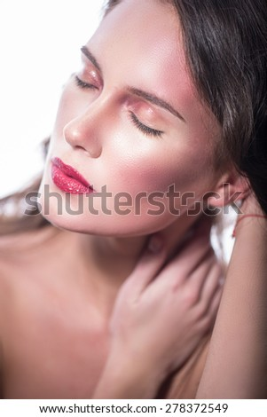 closeup portrait of a young woman. Closing his eyes and sensuality. girl gently massaging his neck - stock photo