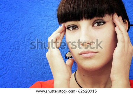 Closeup portrait of a young woman having a headache