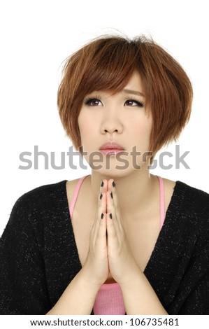 Closeup portrait of a young woman praying - stock photo