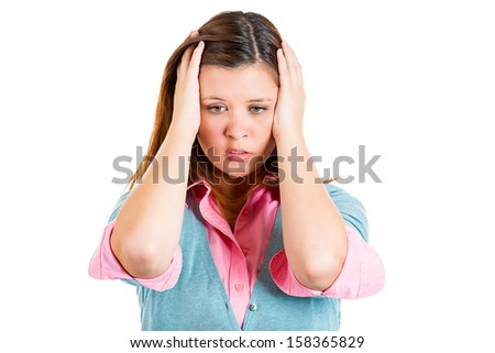 Closeup portrait of a young woman, unhappy student, female worker,  holding hair behind head very upset and sad, depressed and lost, isolated on white background. Human emotions and facial expressions - stock photo