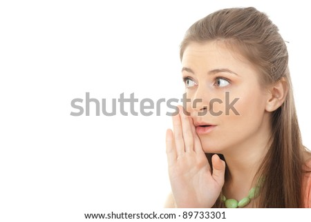 Closeup portrait of a young woman whispering gossips against white background - Copyspace - stock photo