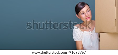 Closeup portrait of a young woman with boxes. Lots of copyspace - stock photo