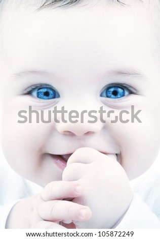 closeup portrait of adorable baby with blue eyes - stock photo