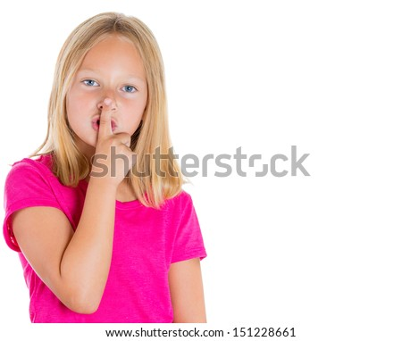 Closeup portrait of adorable blonde girl putting finger up to lips and saying shhh, isolated on white background  - stock photo