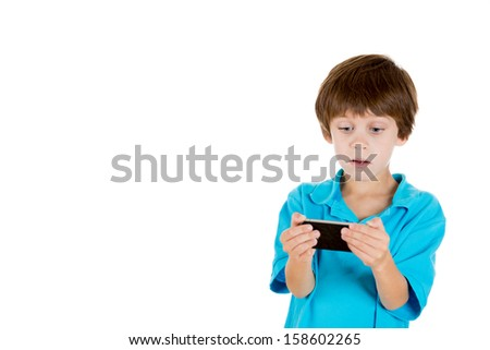 Closeup portrait of adorable boy holding cell phone in hands and shocked by what he sees isolated on white background with copy space - stock photo