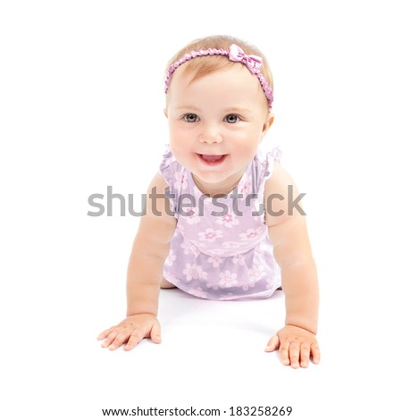Closeup portrait of adorable sweet child crawling in the studio isolated on white background, playful little girl, happy childhood concept - stock photo
