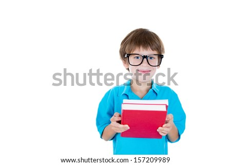 Closeup portrait of adorable young boy with big black glasses holding books, isolated on white background with copy space - stock photo