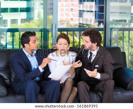 Closeup portrait of agent giving bad news to rich unhappy couple man woman sitting on black couch in house, apartment isolated on city urban background.  Financial budget troubles, adverse life events