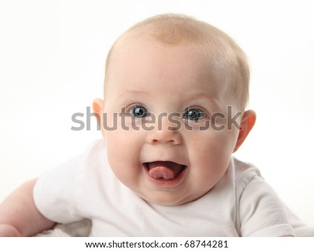 Closeup portrait of an adorable baby with tongue sticking out - stock photo