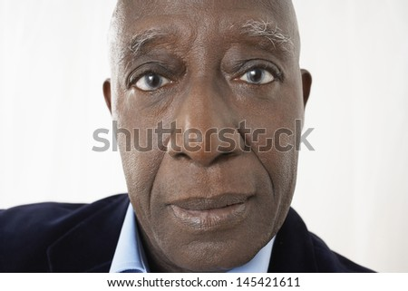 Closeup portrait of an African American senior businessman against white background - stock photo