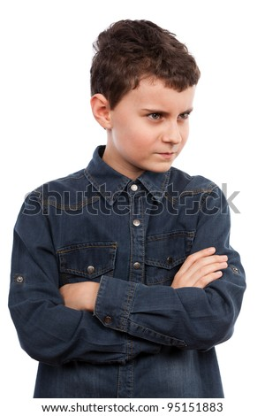 Closeup portrait of an angry boy with his arms folded - stock photo