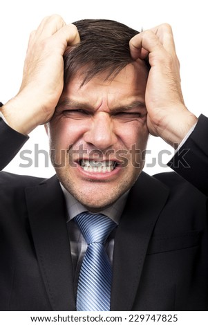 Closeup portrait of an angry businessman isolated on white background  - stock photo