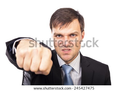 Closeup portrait of an angry businessman threatening with his fist on white background  - stock photo