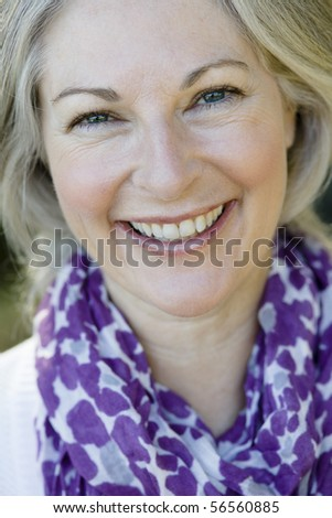 Closeup Portrait of an Attractive Woman Wearing a Purple Scarf - stock photo