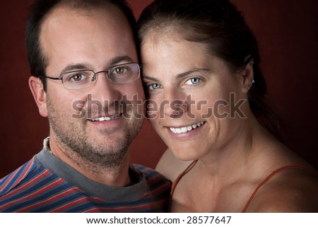 Closeup portrait of an attractive young couple - stock photo