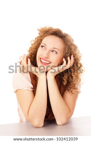 Closeup portrait of an attractive young woman sitting at the desk - stock photo