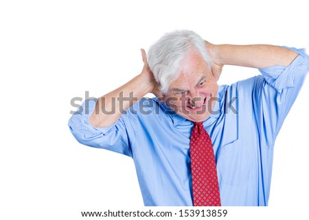 Closeup portrait of an elderly executive, boss, man covering his ears looking down as if to say, stop making that loud noise it's giving me a headache, isolated on white background with copy space - stock photo