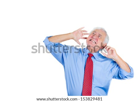 Closeup portrait of an elderly executive, boss, man covering his ears looking up, as if to say, stop making that loud noise it's giving me a headache, isolated on white background with copy space - stock photo
