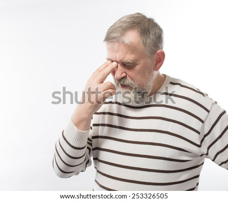 Closeup portrait of an elderly executive, old corporate employee, grandfather with closed eyes, in a melancholic mood, daydreaming, looking clueless, isolated on a white background. Human emotions - stock photo